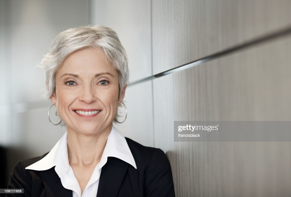 Mature executive business woman smiling : Stock Photo