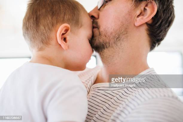 mature father and small son indoors, a close-up. - chest kissing stock pictures, royalty-free photos & images