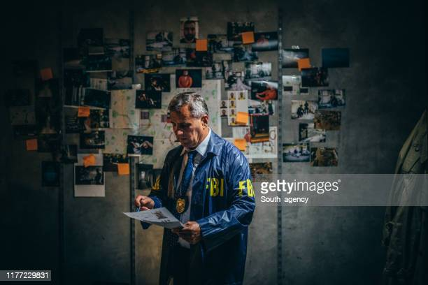 mature fbi agent on a case - evidence stock pictures, royalty-free photos & images