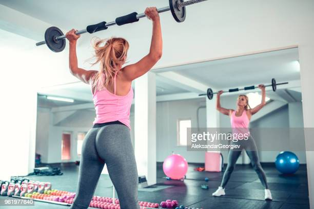 mature female athlete cross training in home gym - beautiful female bottoms stock pictures, royalty-free photos & images