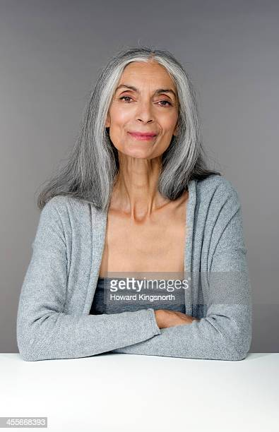 mature female beauty arms crossed - long hair stock pictures, royalty-free photos & images