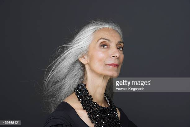 mature female beauty at camera - black background stock pictures, royalty-free photos & images