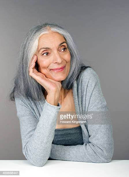 mature female beauty hand on face - long hair stock pictures, royalty-free photos & images
