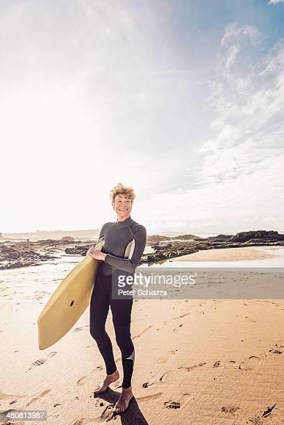 Mature female bodyboarder on Devon coast, UK