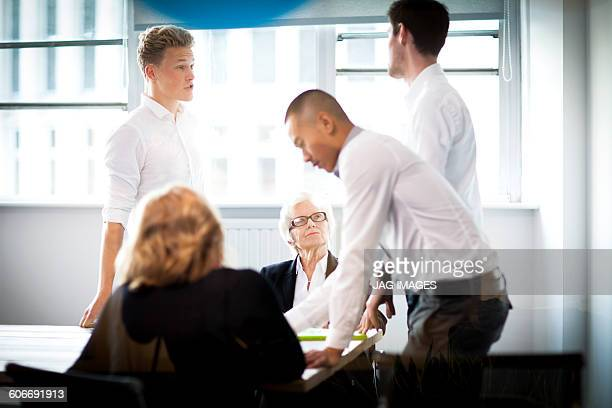 mature female boss meeting with younger colleagues