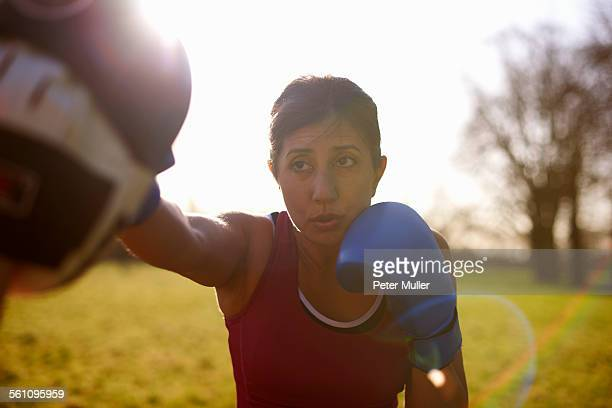 Mature female boxer training in field