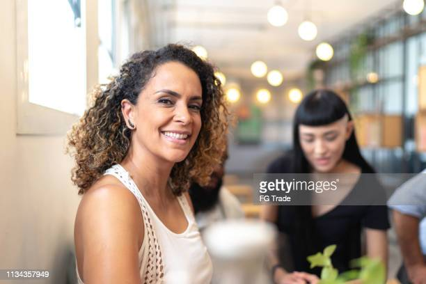 mature female businesswoman portrait at modern startup company - 40 49 years stock pictures, royalty-free photos & images