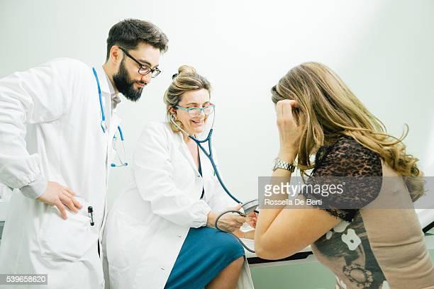 Mature Female Doctor Measuring Blood Pressure