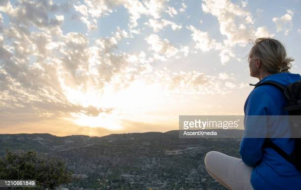 mature female hiker looks off to view - motivation stock pictures, royalty-free photos & images