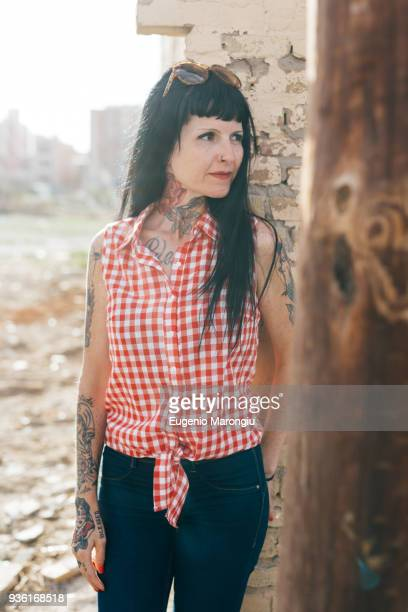 mature female hipster by demolished building - pants pulled down stock pictures, royalty-free photos & images