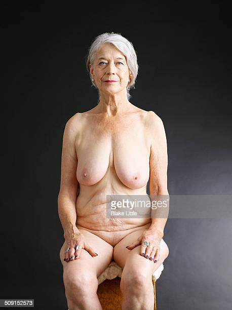 Mature female nude seated studio
