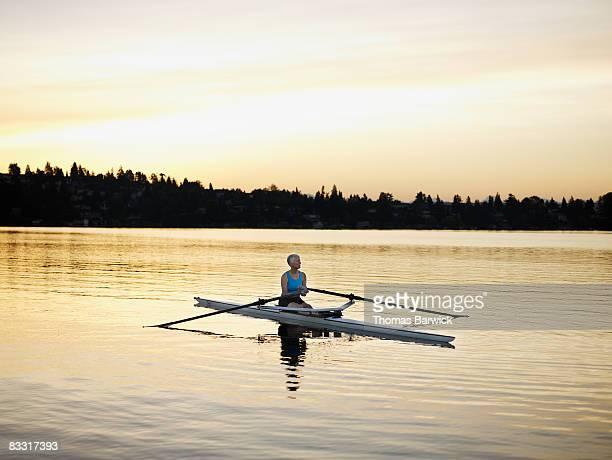 Mature female rower in single scull