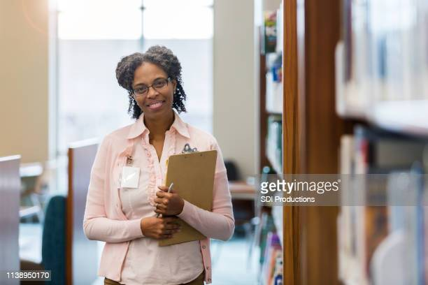 mature female school librarian - school principal stock pictures, royalty-free photos & images