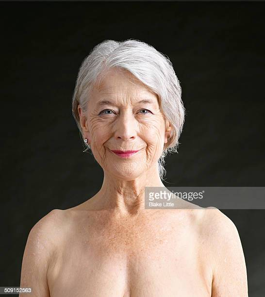 Mature female smiling closeup studio