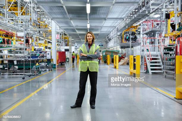 mature female supervisor with arms crossed - plant stock pictures, royalty-free photos & images