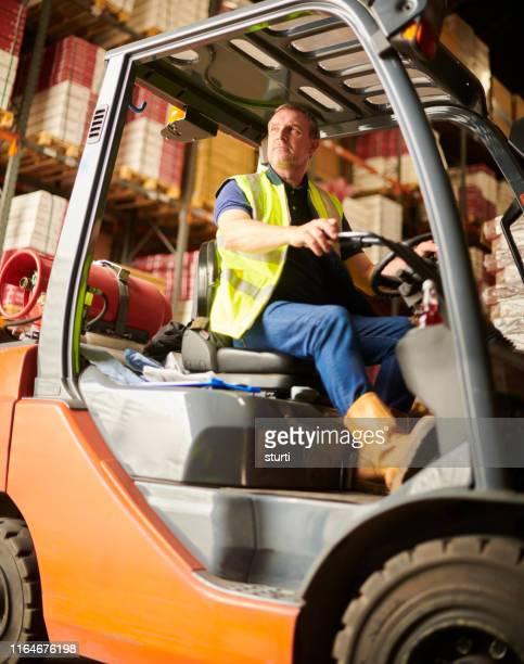 mature fork lift driver - factory stock pictures, royalty-free photos & images