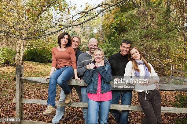 mature friends around a fence - 40 49 jaar stockfoto's en -beelden