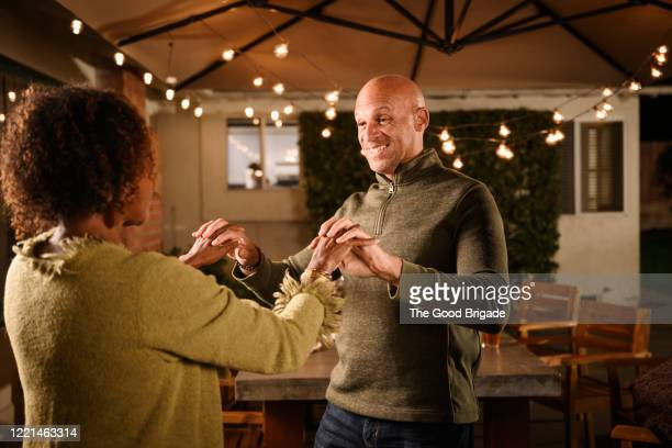 mature friends dancing at outdoor party - free stock pictures, royalty-free photos & images