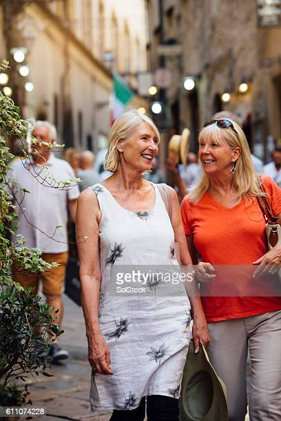 Mature Friends Looking Around Old Town Italy