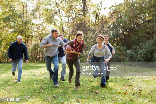 Mature Friends Playing Football Stock Photo - Getty Images