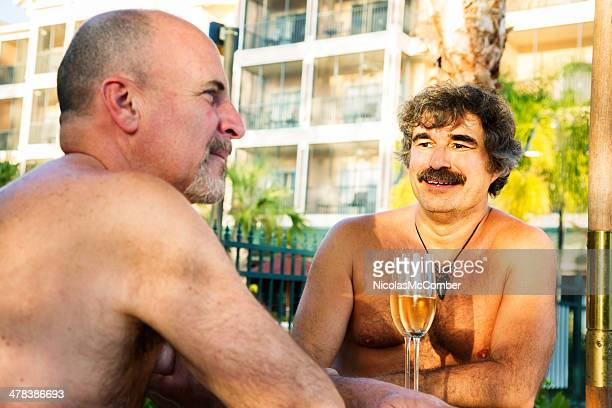 mature gay couple enjoying a florida vacation - hairy man stock pictures, royalty-free photos & images