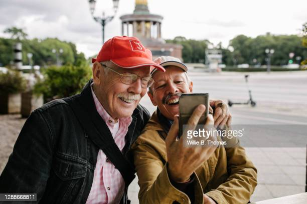 mature gay couple taking selfie together - central berlin stock pictures, royalty-free photos & images