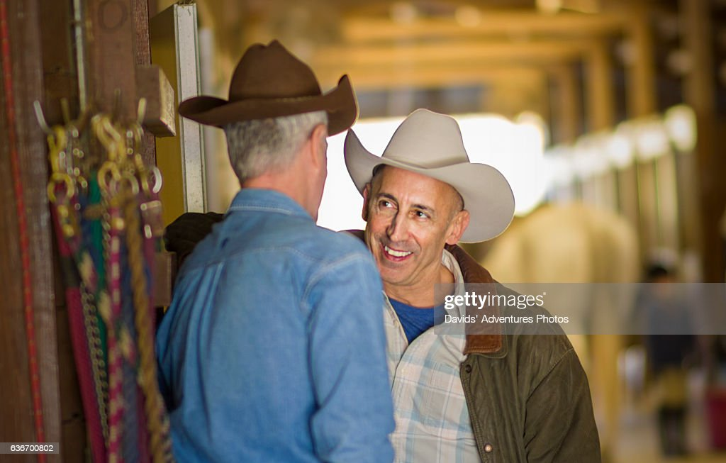 Mature Gay Cowboys Talking And Possibly Flirting With Each Other Inside Horse Stable -7051