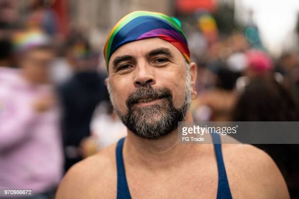 mature gay man on gay parade - gay man stock pictures, royalty-free photos & images