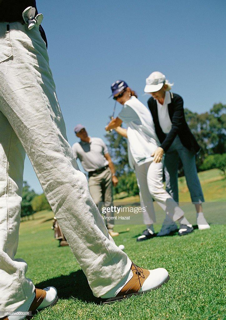 Mature golf players : Stockfoto
