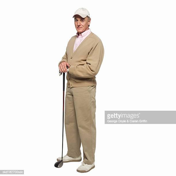 Mature golfer holding golf club