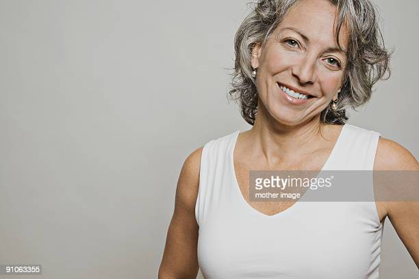 mature gray haired woman smiling - 45 49 years stock pictures, royalty-free photos & images