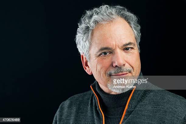 mature grey haired man smiling, portrait. - ファスナー ストックフォトと画像