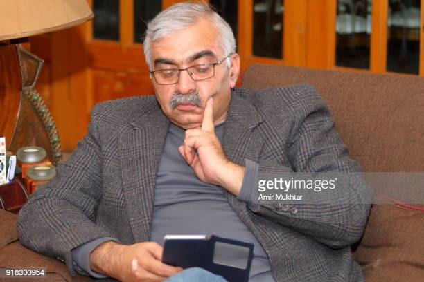 A mature handsom man busy in using cell phone