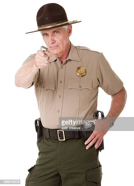 Mature Highway Patrolman Pointing