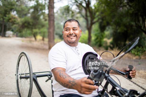Mature Hispanic Man Riding Handcycle