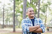 Mature Hispanic man wearing plaid shirt