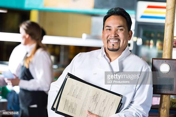Mature Hispanic restaurant owner in local Tex-Mex diner