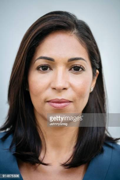 mature hispanic woman headshot portrait - police mugshot stock pictures, royalty-free photos & images