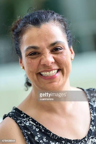 Mature hispanic woman laughing