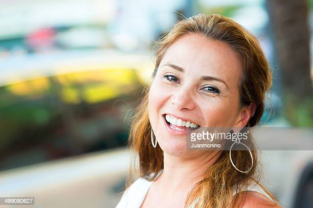 Mature hispanic woman laughing