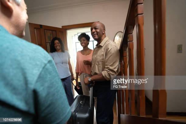 mature host welcome african family guest at house rental / bed and breakfast accommodation - guest stock pictures, royalty-free photos & images