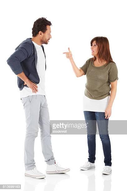 mature interracial couple having an argument - ruziemaken stockfoto's en -beelden