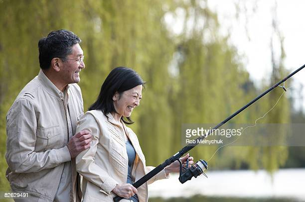 Mature Japanese couple fishing.