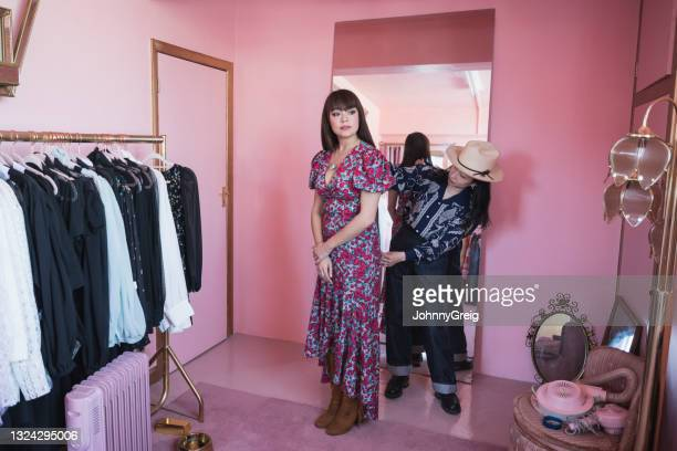 mature japanese fashion designer measuring artist's model - fashion collection stock pictures, royalty-free photos & images