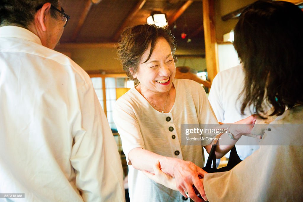Mature Japanese female greeting an old friend : Stock Photo