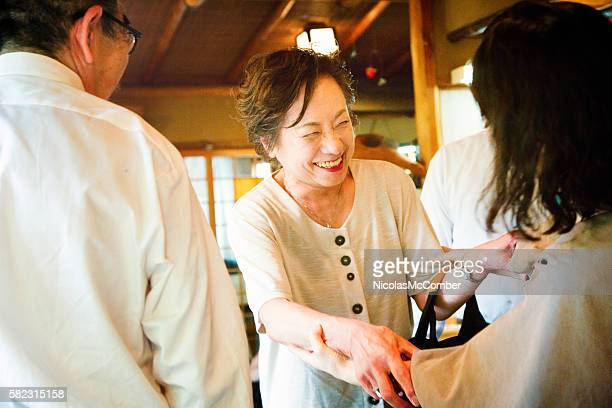 mature japanese female greeting an old friend - niece stock photos and pictures