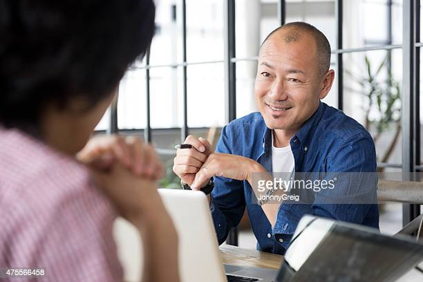 Mature Japanese man in meeting