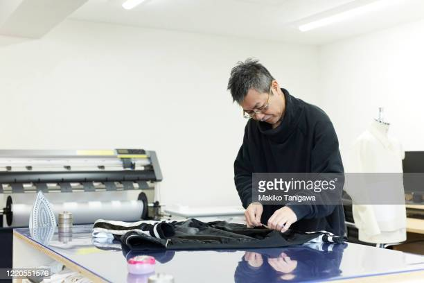 mature japanese man working in fashion industry - japanese ethnicity stock pictures, royalty-free photos & images