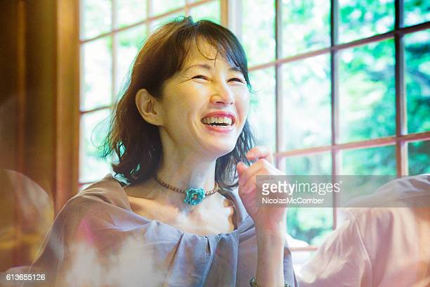 Mature Japanese woman laughing on afternoon date