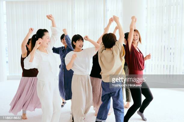mature japanese women dancing in fitness studio - active lifestyle stock pictures, royalty-free photos & images